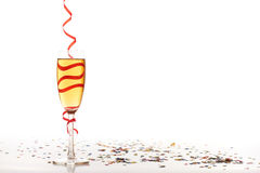 Champagne glass. With christmas confetti Stock Image