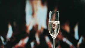 Champagne glass close-up, champagne bubbles. Celebrating valentine`s day.