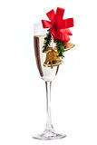 Champagne glass decorated with Christmas bells stock images