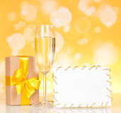 Champagne glass and empty card Royalty Free Stock Images