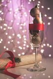 Champagne glass filled with Christmas toys,gift box with red bow hinting at upcoming holidays and New Years celebration, Merry Chr. Istmas royalty free stock photos