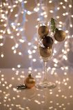 Christmas background. Champagne glass filled with Christmas toys. Champagne glass filled with Christmas toys, hinting at upcoming holidays and New Years stock photography