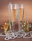 Champagne glass and gift box Stock Photography
