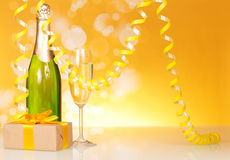 Champagne, glass, gift and serpentine Royalty Free Stock Photos