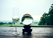 Champagne glass with glass ball Royalty Free Stock Photos