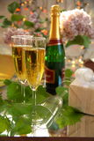 Champagne in glass and grape-vine leaves Stock Photo