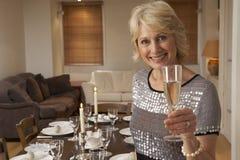 champagne glass holding woman Στοκ Φωτογραφία