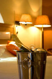Champagne and glass in an Hotel room Royalty Free Stock Image