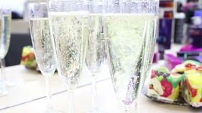 Champagne by the glass. Pours girl stock footage