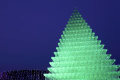 Champagne glass pyramid. Illuminated champagne glass pyramid at night, background Royalty Free Stock Images
