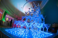 Champagne glass pyramid on wedding party. Tower of glasses of wine.  Royalty Free Stock Images