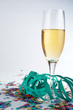 Champagne glass, ribbons and confetti Stock Photography