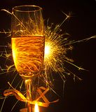 Champagne glass and sparcle Royalty Free Stock Image