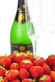 Champagne glass and strawberries royalty free stock images