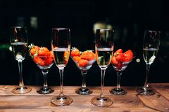Champagne in a glass with strawberries in night. royalty free stock images