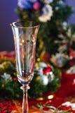 Champagne Glass vacío en la tabla del Año Nuevo Fotografía de archivo libre de regalías
