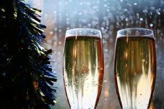 Champagne glass window rain drops royalty free stock image