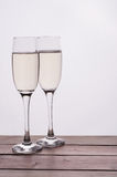Champagne glass on wooden table against white background Royalty Free Stock Photos
