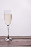 Champagne glass on wooden table against white background Royalty Free Stock Photography