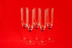Champagne glasses. Five champagne glasses on red background Royalty Free Stock Images