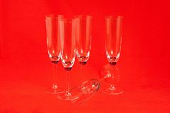 Champagne glasses. Five champagne glasses on red background Stock Images