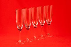 Champagne glasses. Five champagne glasses on red background Royalty Free Stock Photography