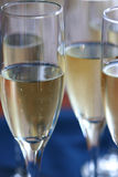 Champagne Glasses. Sparkling chmapagne in flute glasses royalty free stock image