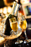 Champagne glasses. Two champagne glasses and bottles Stock Photo
