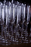 Champagne Glasses. Rows of empty champagne glasses royalty free stock image