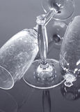 Champagne glasses. A broken champagne flute along side a whole one, on a black background stock photography