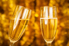 Champagne Glasses. Two Champagne Glasses with golden background royalty free stock image