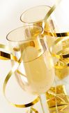 Champagne in glasses. Two glasses with champagne and gift near on light background stock photography