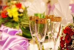Champagne glasses. With flowers on the background Stock Image