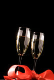 Champagne glasses. With decoration isolated on black Stock Photos