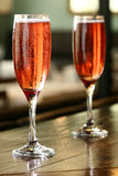 Champagne glasses. Two kir royal cocktails Stock Photo