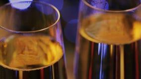 Champagne glasses against christmas tree bokeh lights stock video