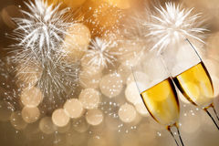 Champagne glasses against holiday lights Royalty Free Stock Image