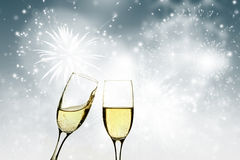 Champagne glasses against holiday lights Stock Photo