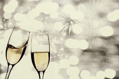 Champagne glasses against holiday lights Royalty Free Stock Photos