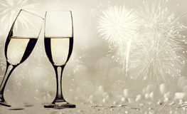 Champagne glasses against holiday lights Stock Image
