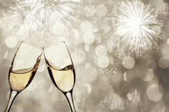 Champagne glasses against holiday lights Stock Photography