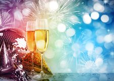 Champagne glasses against New Years background. Two champagne glasses against New Years background stock image