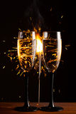 Champagne glasses against sparkler background Royalty Free Stock Photography