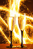 Champagne glasses against sparkler background Stock Images