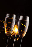 Champagne glasses against sparkler background Royalty Free Stock Image