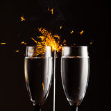 Champagne glasses against sparkler background Stock Photos
