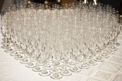 Champagne glasses arranged in heart shape royalty free stock photography