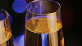 Champagne in glasses on a background of the Christmas tree and lights stock video footage