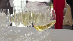 Champagne glasses at banquet. Luxury expensive decoration set wedding table camera movement stock video footage