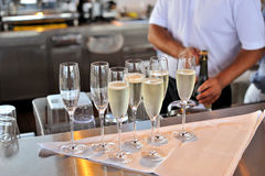 Champagne glasses in the bar Stock Images